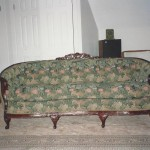 vintage couch with green floral fabric