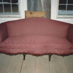 vintage couch with maroon fabric