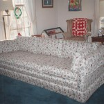 reupholstered couch with white floral fabric